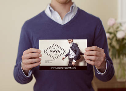 Man holding flyer with company logo